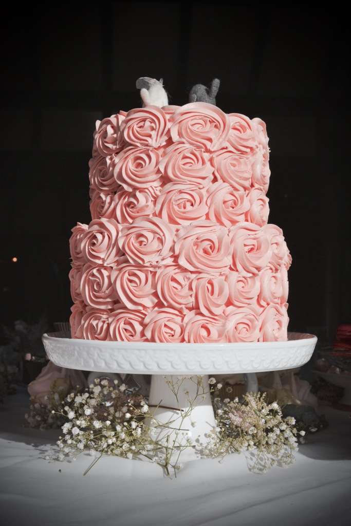 Two tiers of sponge soaked in a vanilla and Chambord syrup, filled with raspberry jam and buttercream, covered in piped buttercream roses.