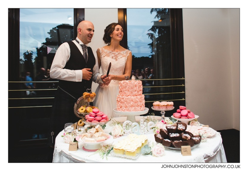 Allan and Carly cutting the cake. Photograph courtesy of John Johnston Photography.