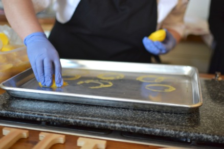Smoothing the chocolate edges on a hot oven tray for a perfect finish